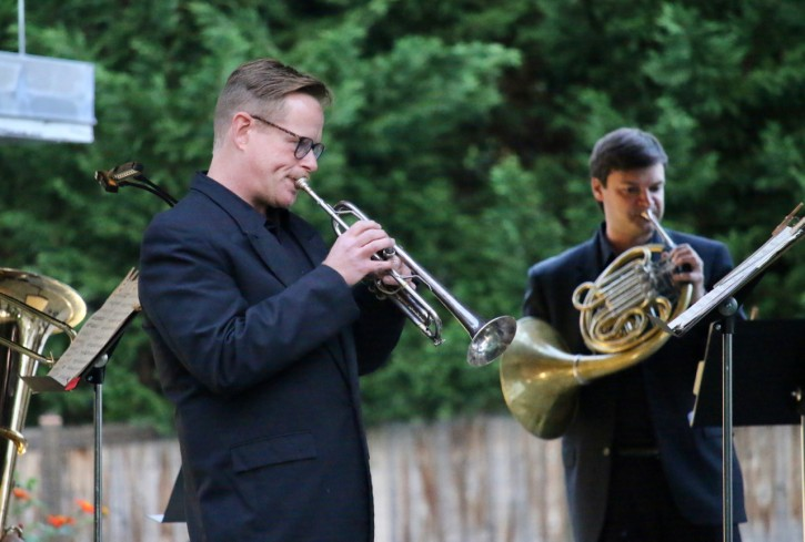 PSO Brass Quintet members Jerry Bryant and Jonathan Clark performing outside