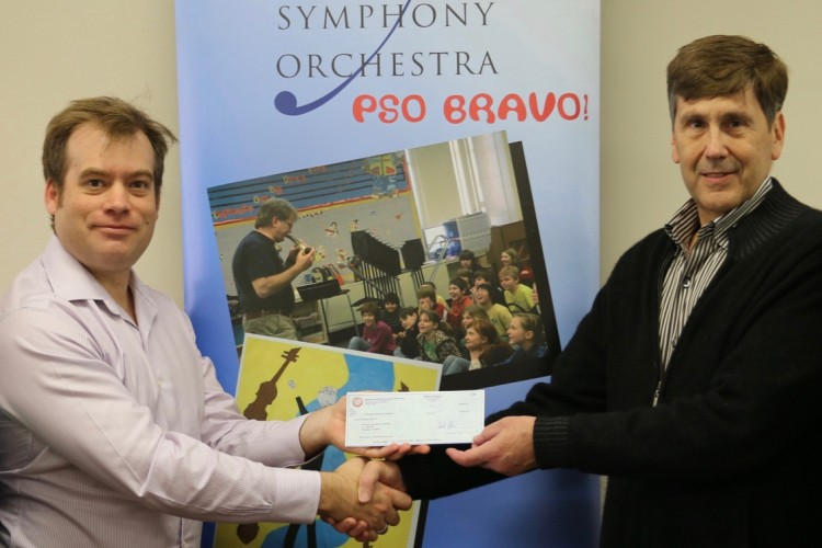 Check presentation to Executive Director Marc Uys