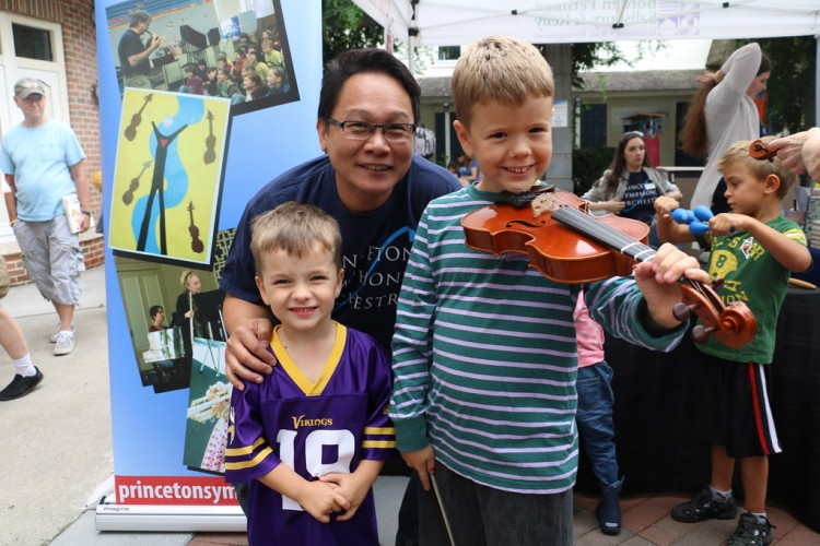 Violinist Kevin Tsai with boys at Instrument Petting Zoo