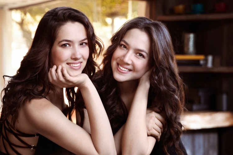 Twin sisters Christina and Michelle Naughton smiling together