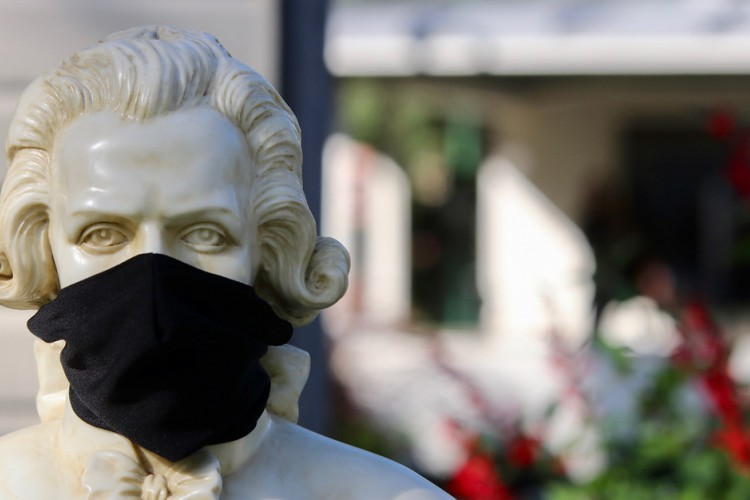 Mozart bust wearing black mask