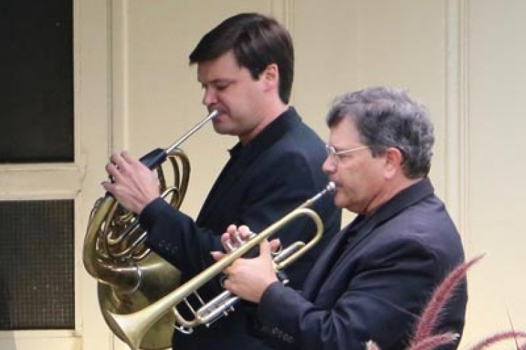 Jonathan Clark plays horn and Tom Cook plays trumpet