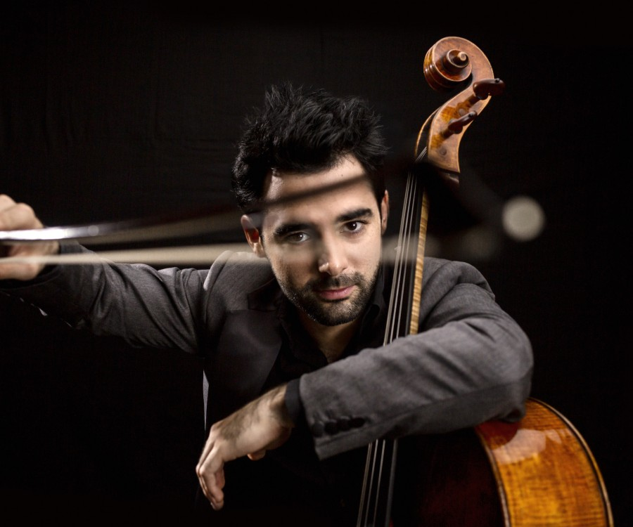 Pablo Ferrández peers through the bow of his cello.