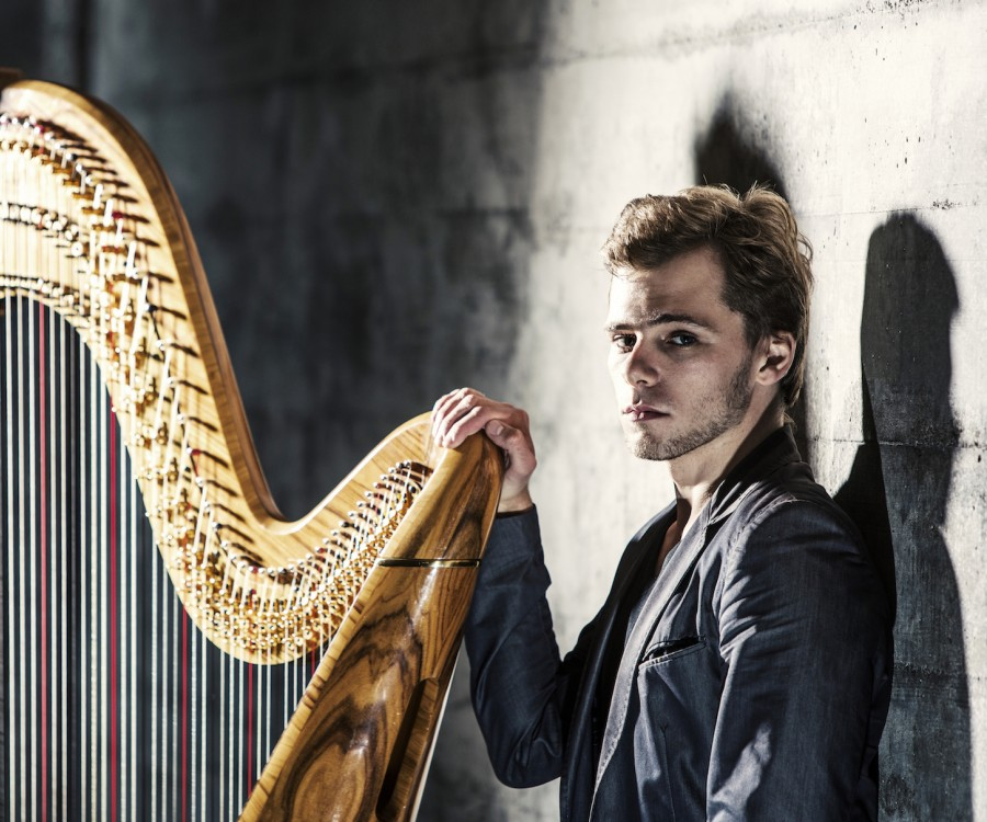 Alexander Boldachev stands by his harp.