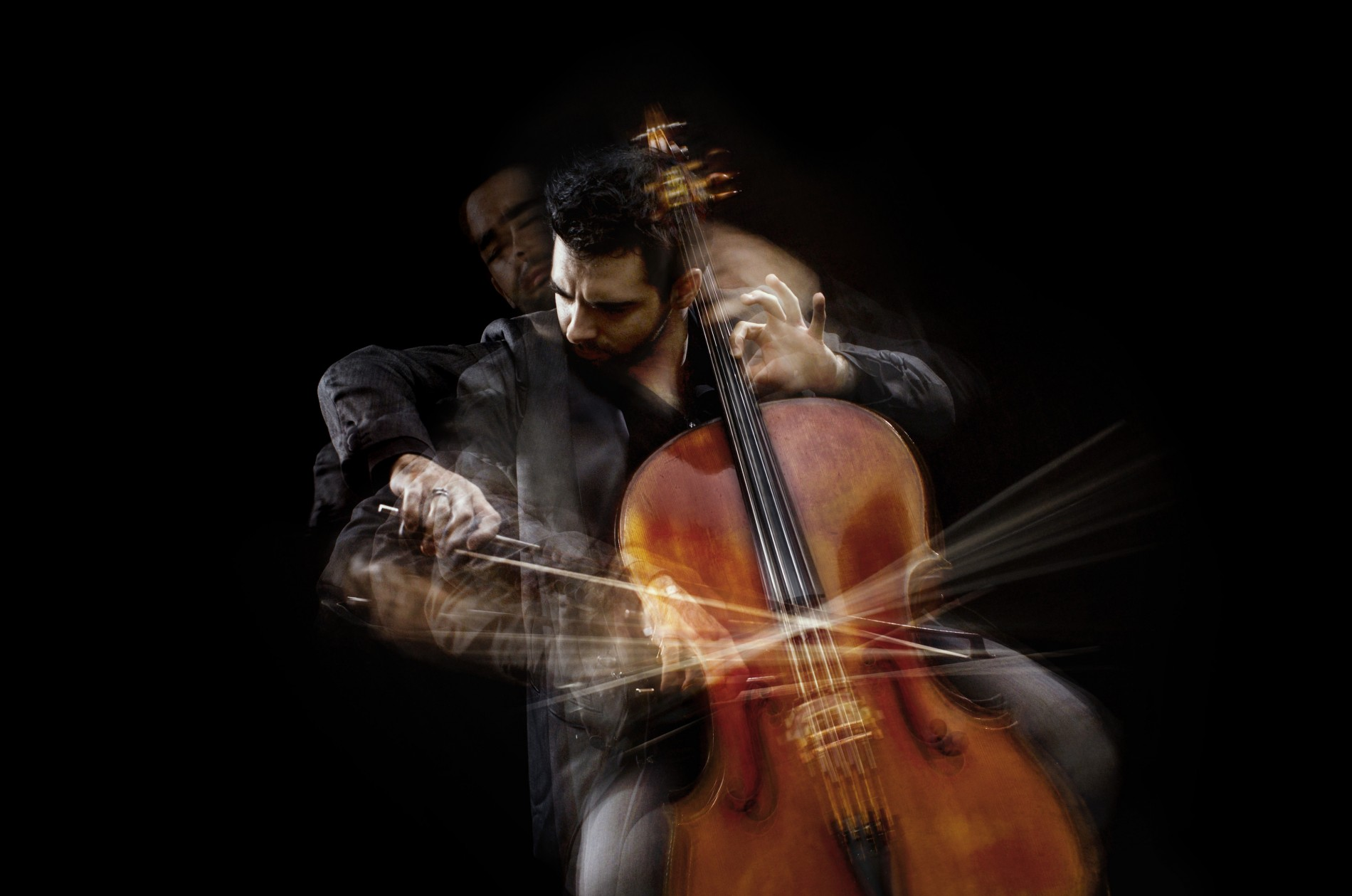 Pablo Ferrández playing the cello against black background