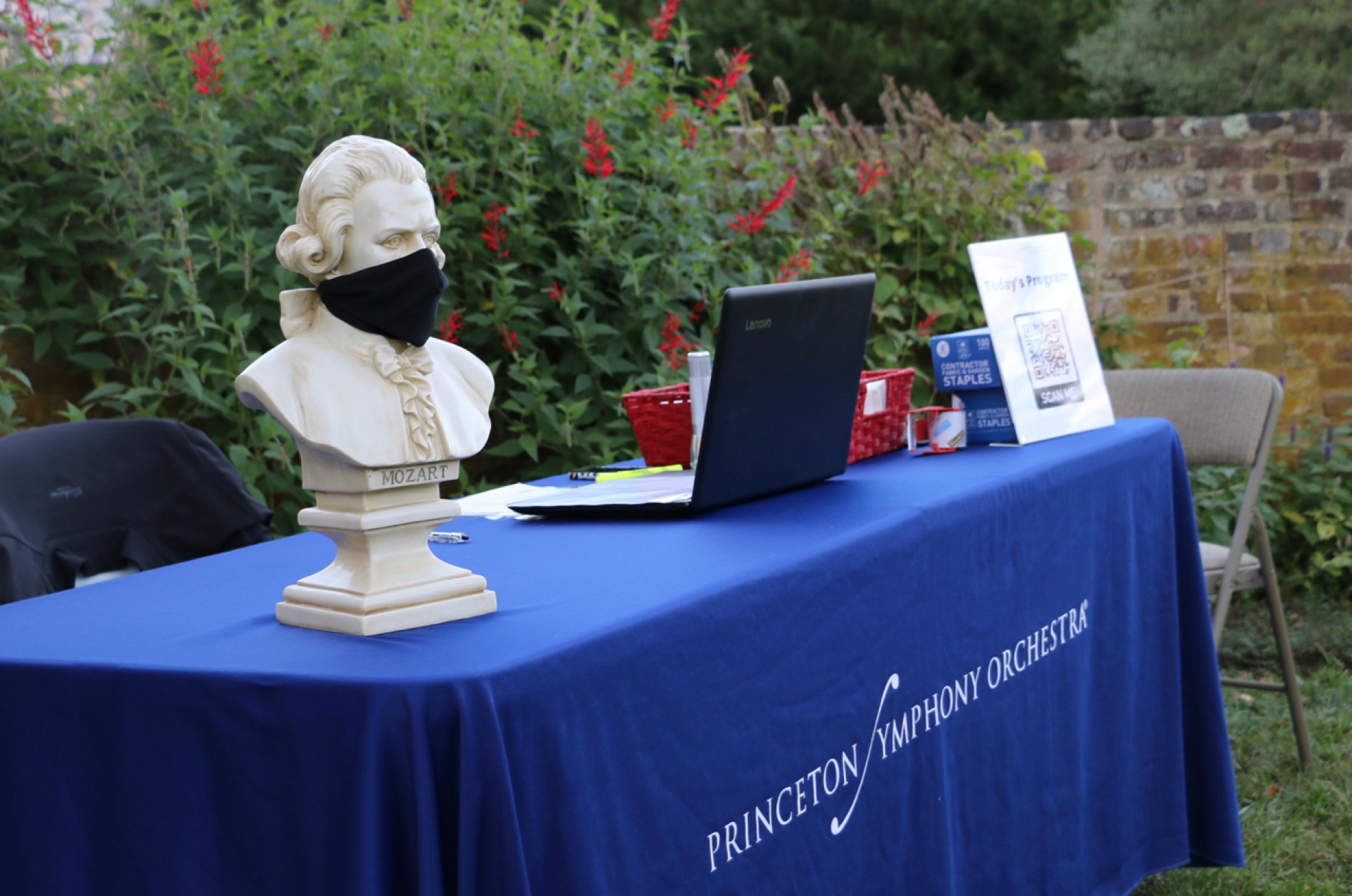 PSO check-in table with masked Mozart